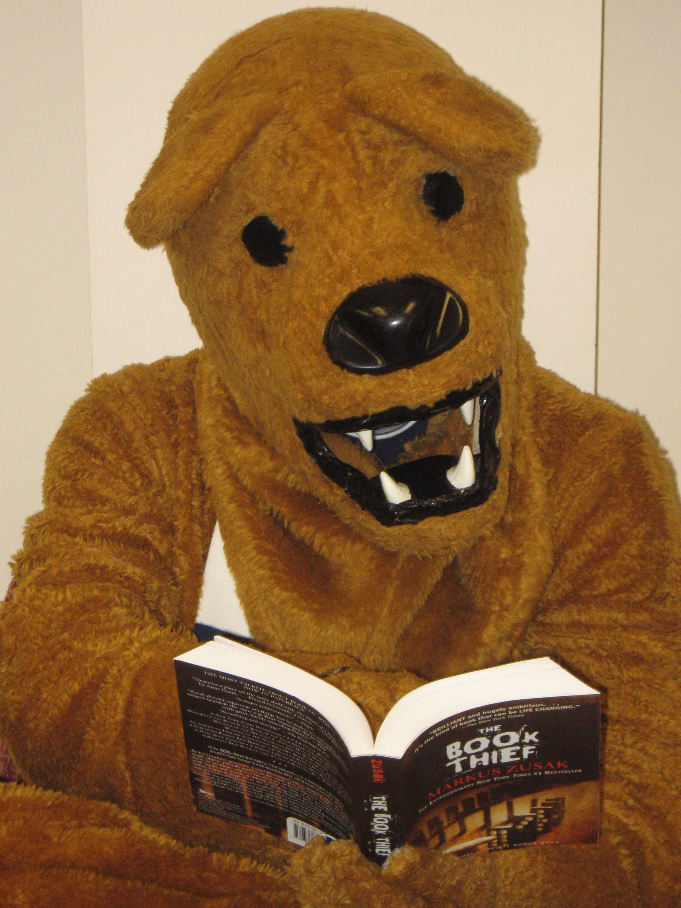 Image result for nittany lion reading a book